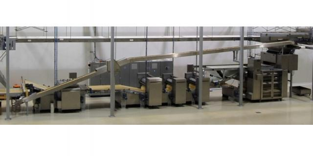 Baker Perkins forming line: (from right to left) laminator, 3 gauge roll units, relaxation conveyor, rotary cutter, scrap lift and return conveyors