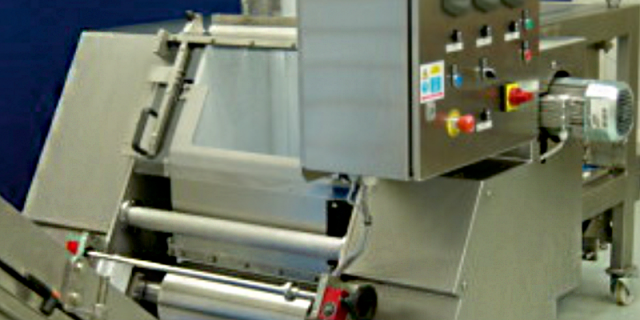 Automatic dough feed system from Arrow Design Services with options for adjustable dough gate from live bottom feeder, sheeting rolls, kibbler, chunker arrangements