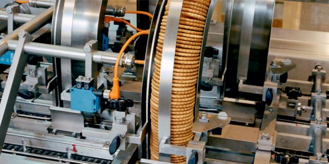 Biscuit feed chutes on a Baker Perkins high speed sandwiching machine