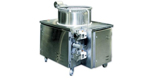 FIG 3   Baker Perkins cream feed system with two pumps