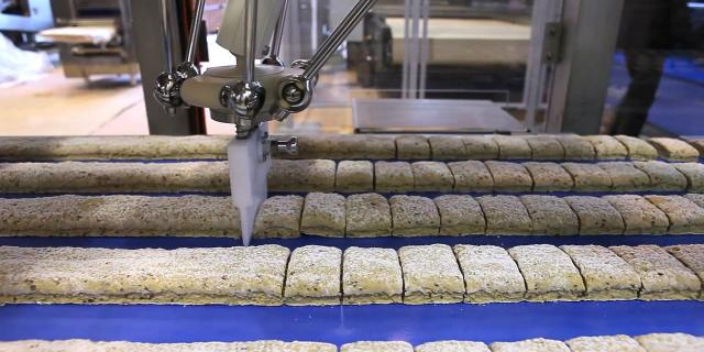 Laminating in biscuits making process